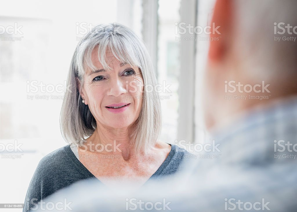 Candid portrait of senior woman with grey bobbed hair stock photo