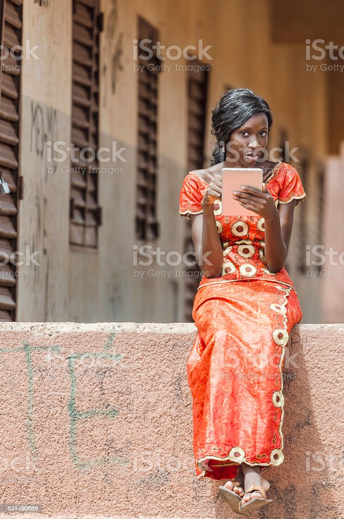 Candid Shot: Black Girl Studying Reading Learning Her Lesson Tablet stock photo