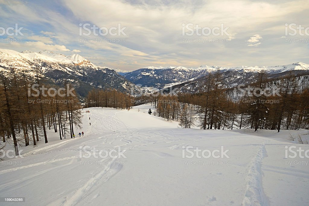 Candid ski tour slope in scenic valley stock photo