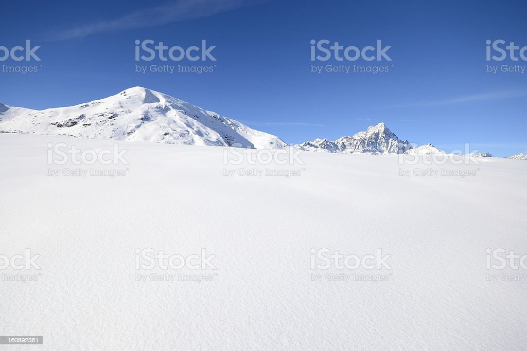 Candid slope and snowcapped mountains royalty-free stock photo