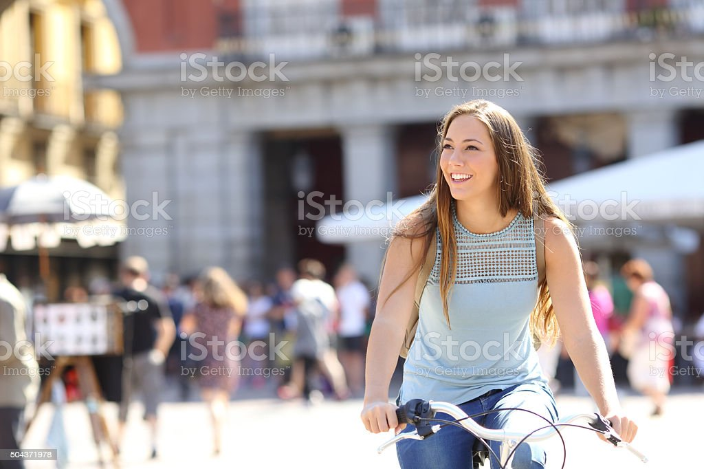 Candid tourist cyclist sightseeing stock photo