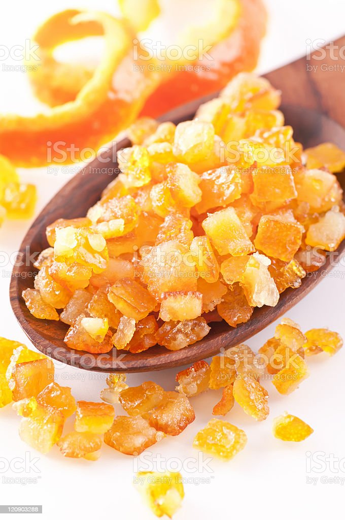 Candied diced orange peel on spoon stock photo