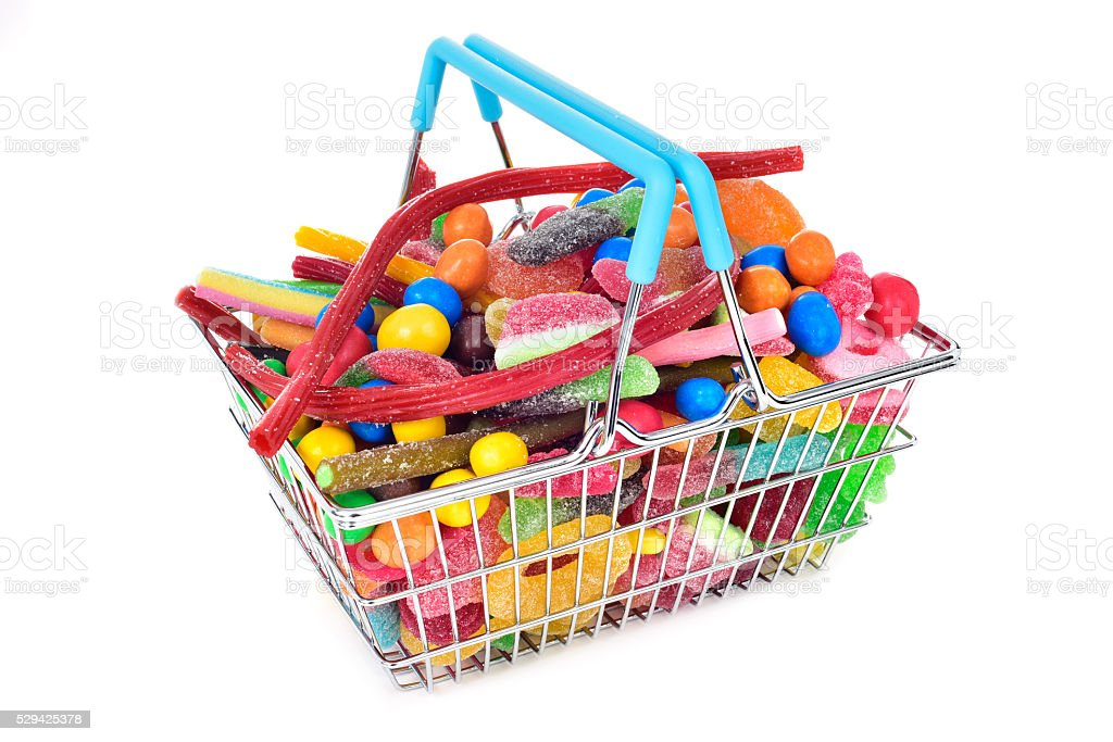 candies in a shopping basket stock photo