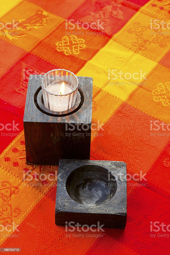 Candle and Ashtray on a Bright Mexican Blanket royalty-free stock photo