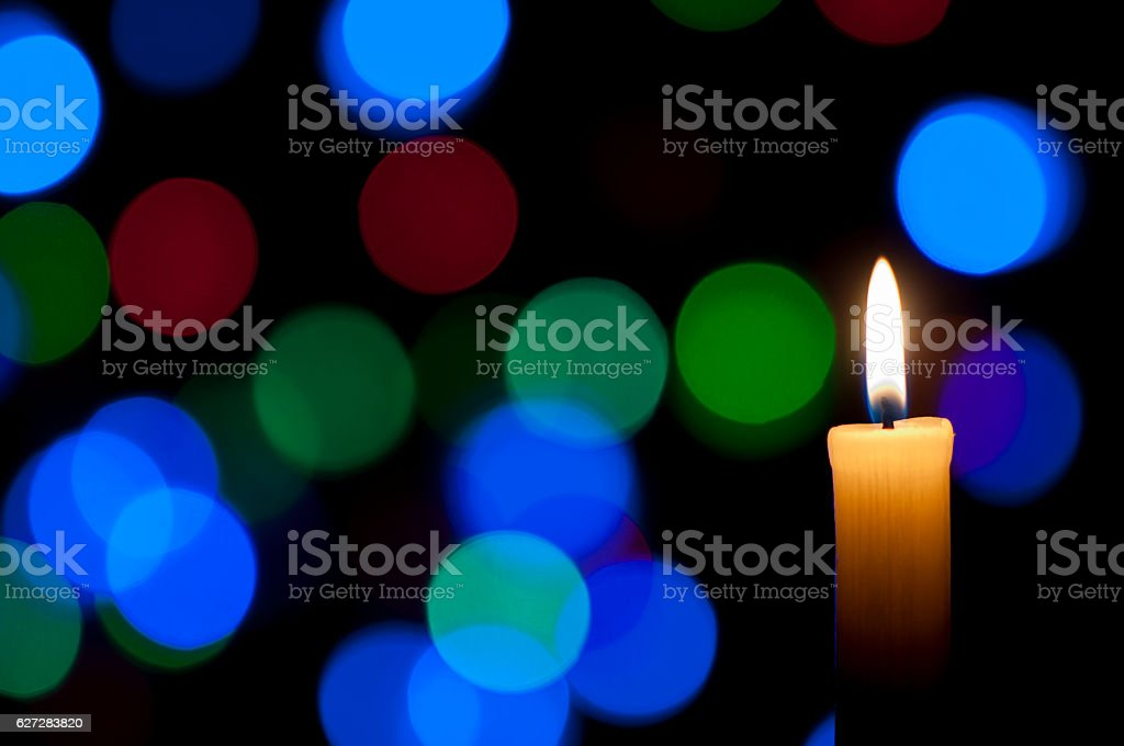 Candle and Christmas background stock photo