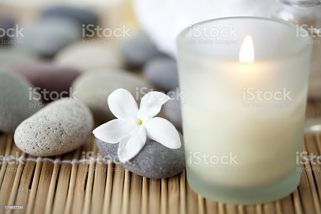 Candle and flower at spa stock photo