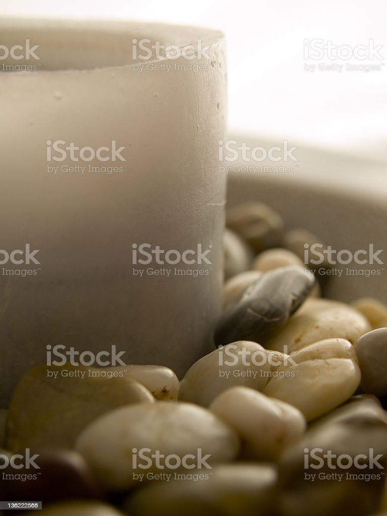 candle and pebbles stock photo