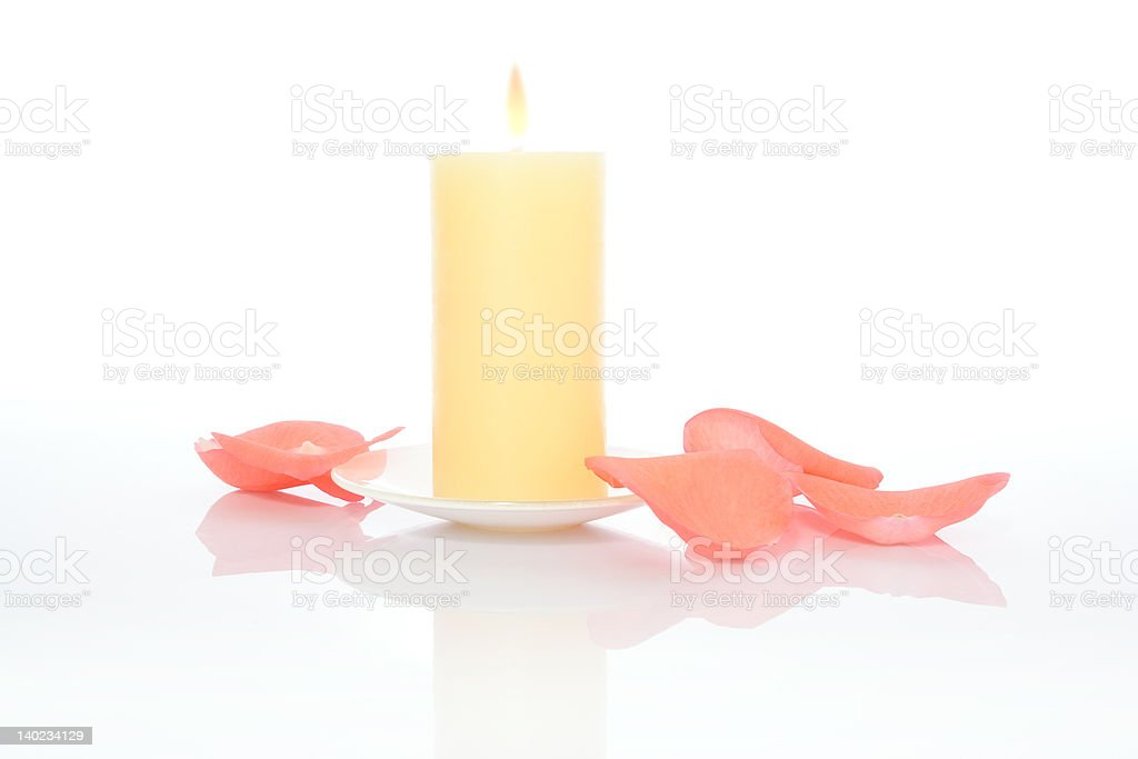 Candle and Pink Petals royalty-free stock photo