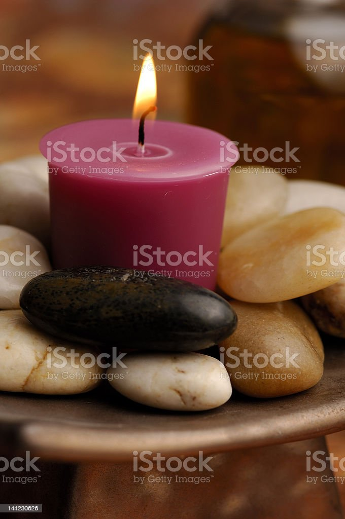 Candle and river stones royalty-free stock photo