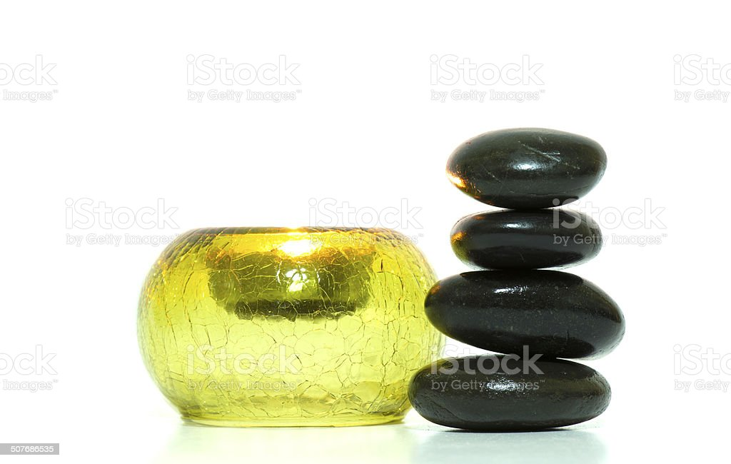 Candle and stones stock photo