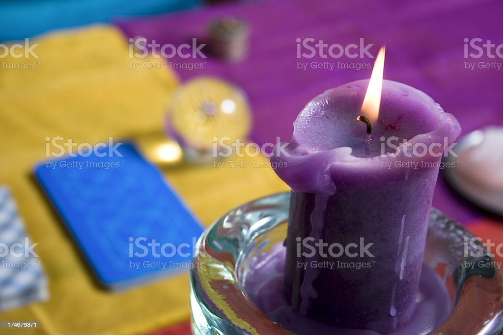 Candle and tarot cards stock photo