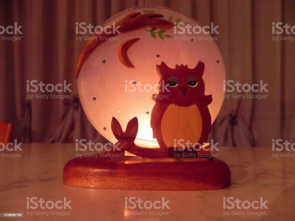 Candle back Owl stock photo