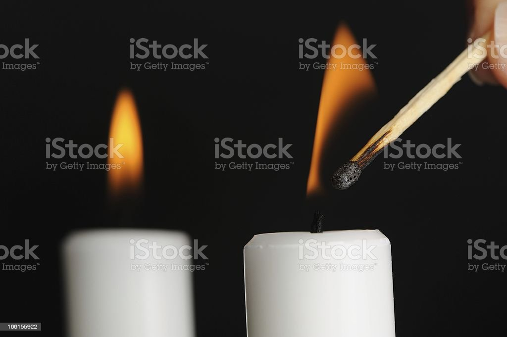 Candle Being Lit with Match royalty-free stock photo