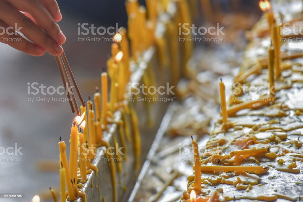 Candle Buddha in temple stock photo