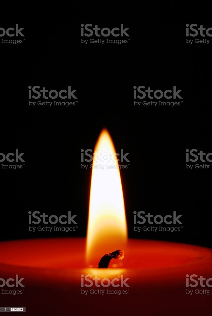 Candle burning in the dark royalty-free stock photo