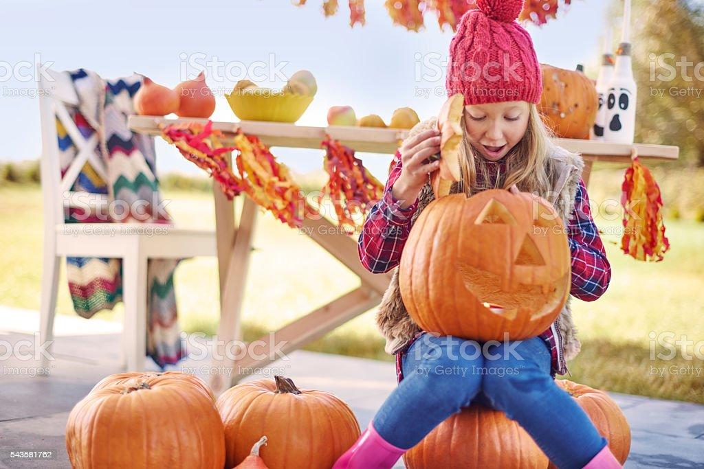 Candle burns in my Halloween's pumpkin stock photo