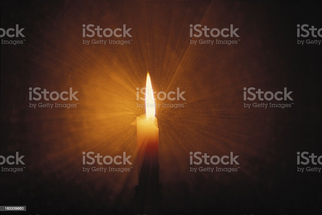 Candle flame light rays stock photo