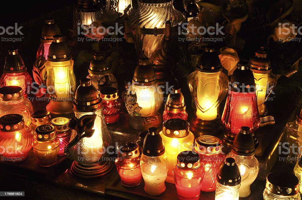 Candle flames illuminatingduring the night of All Saint's Day stock photo
