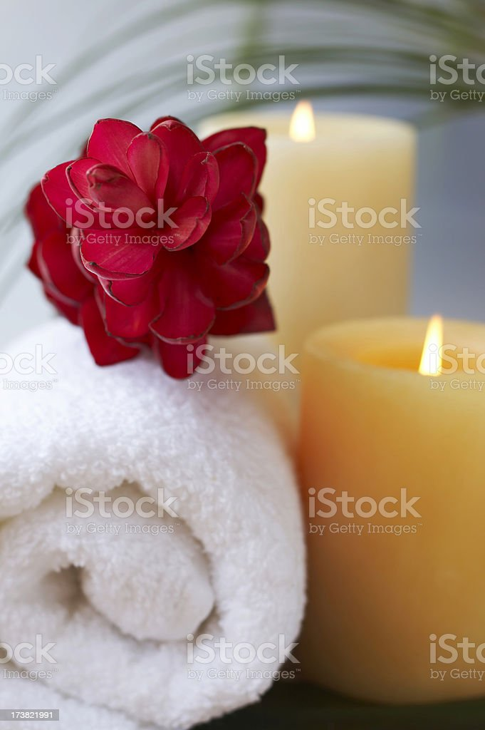 candle, flower, towel royalty-free stock photo