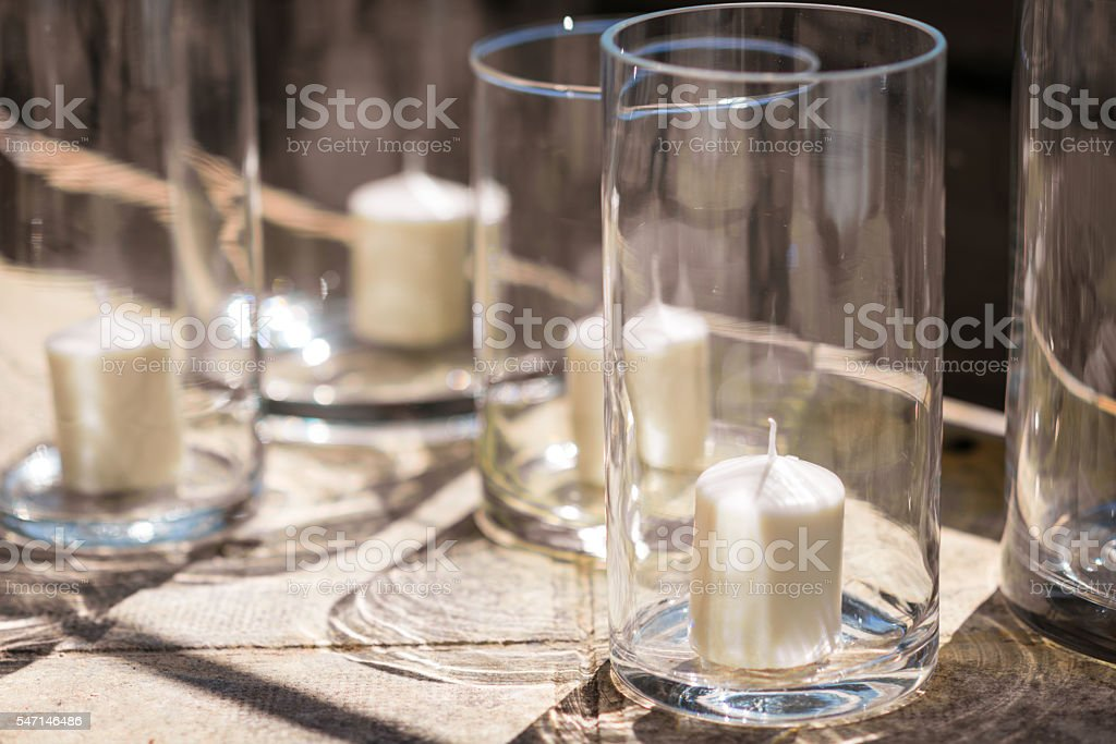 candle glass decoration in sunlight stock photo