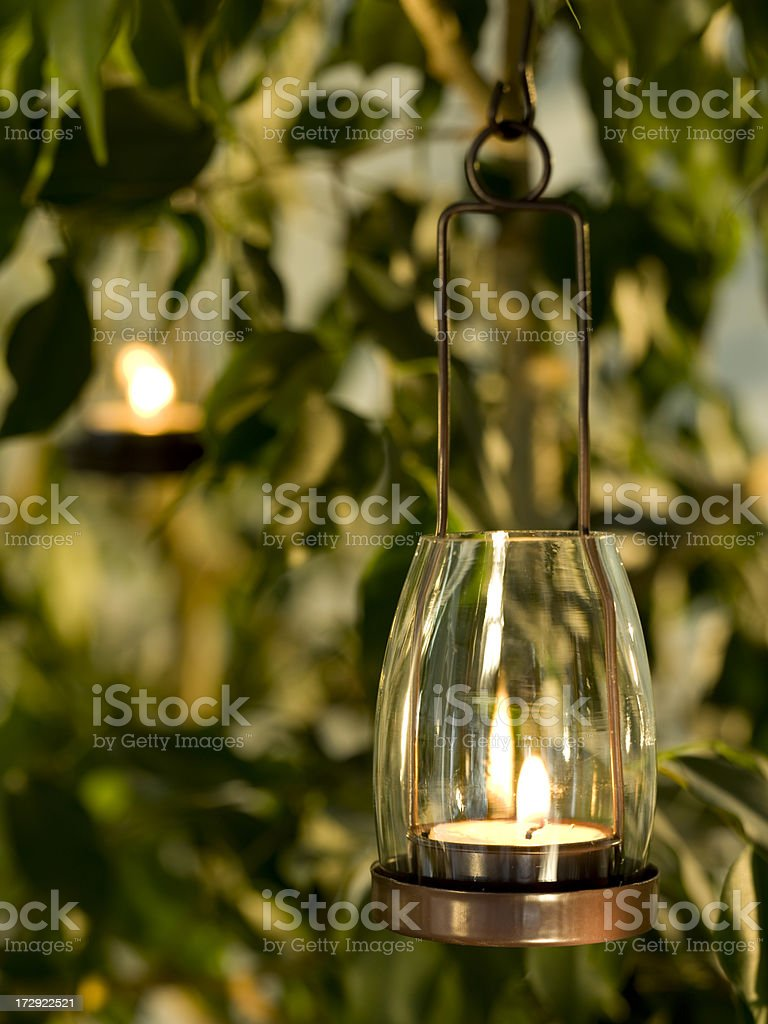 Candle hanging in a yard royalty-free stock photo