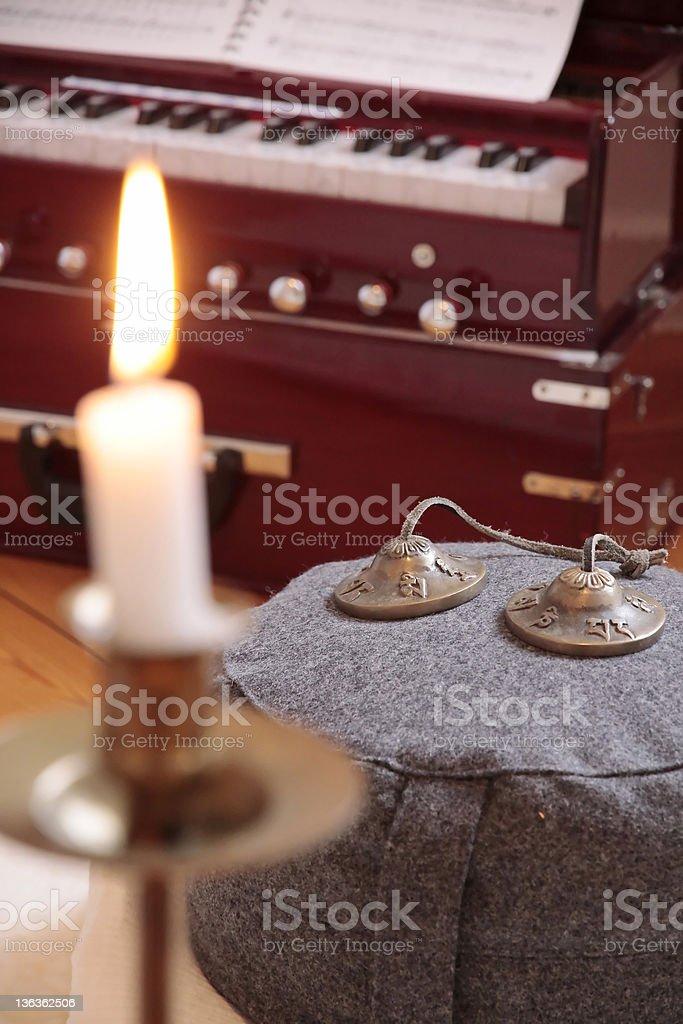 Candle, harmonium and cymbal stock photo