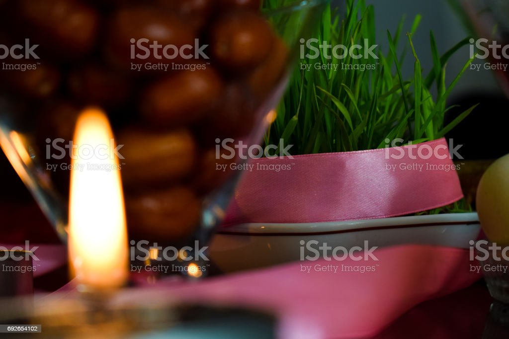 Candle in a Haft-Seen Table stock photo