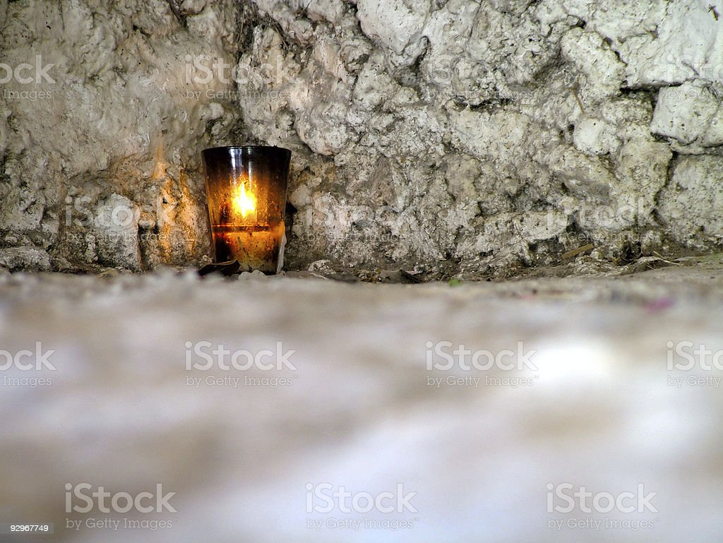 Candle in a Temple royalty-free stock photo