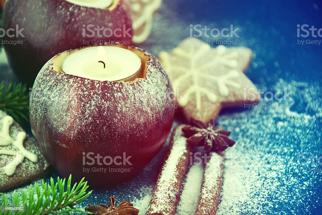 Candle in apple - beautiful christmas table decoration stock photo