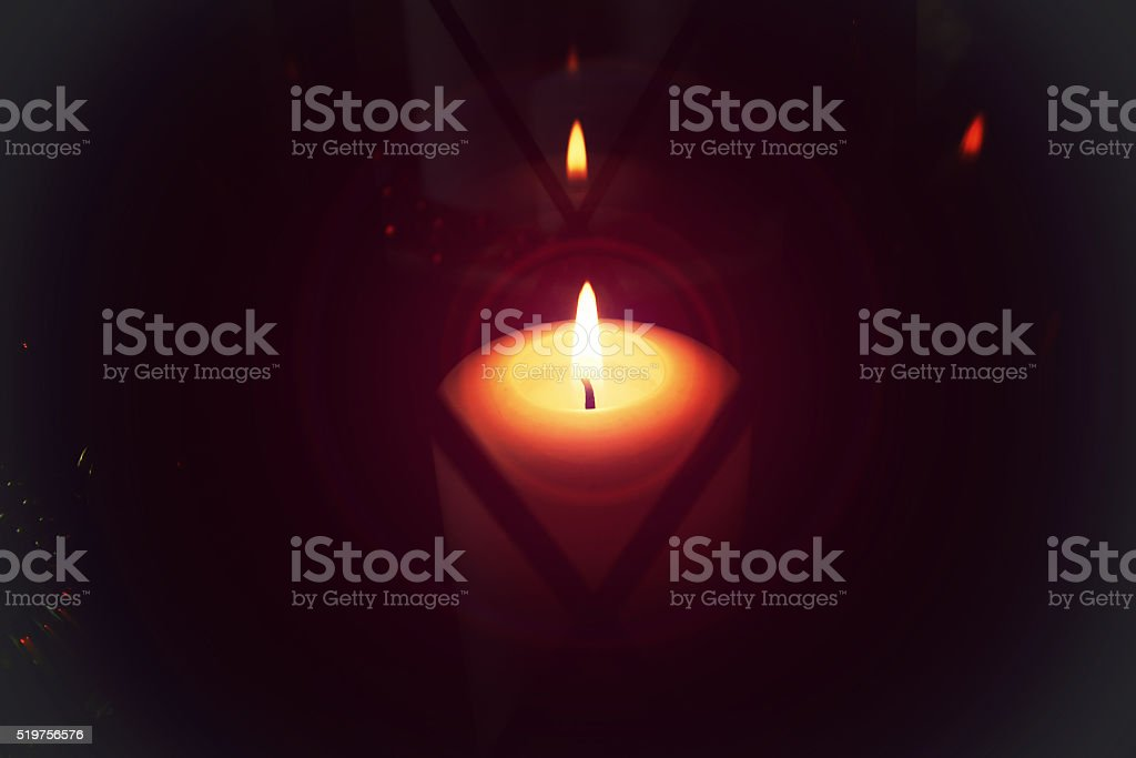 candle in lamp macro stock photo