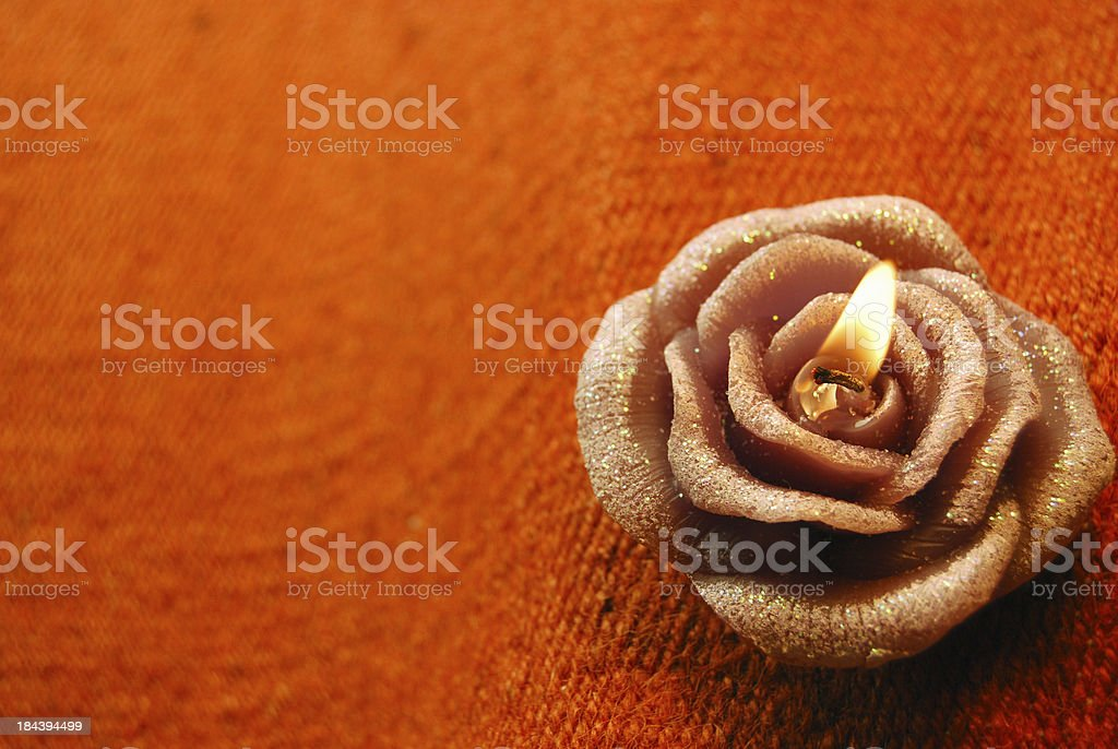 Candle in rose shape royalty-free stock photo