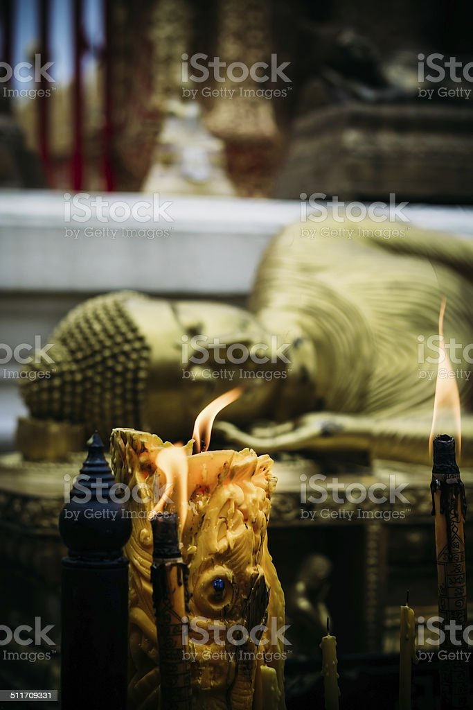 Candle in Tample stock photo