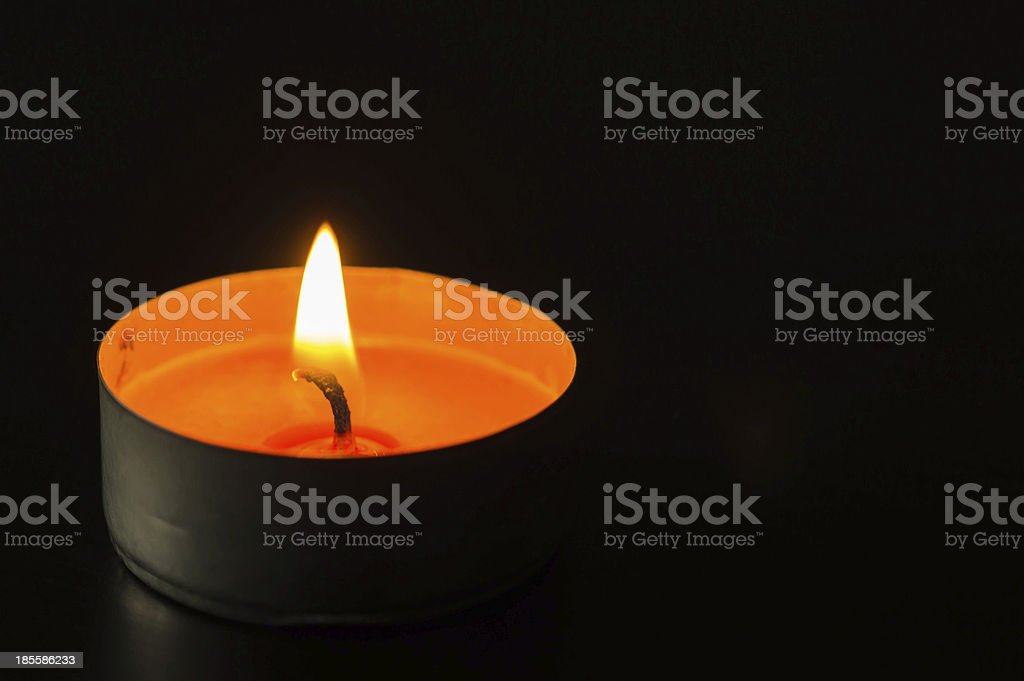Candle in the dark stock photo