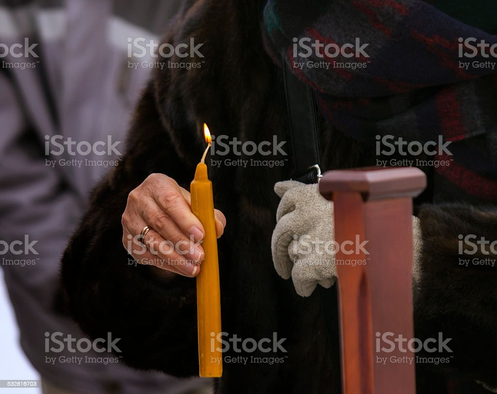 Candle in the hand stock photo