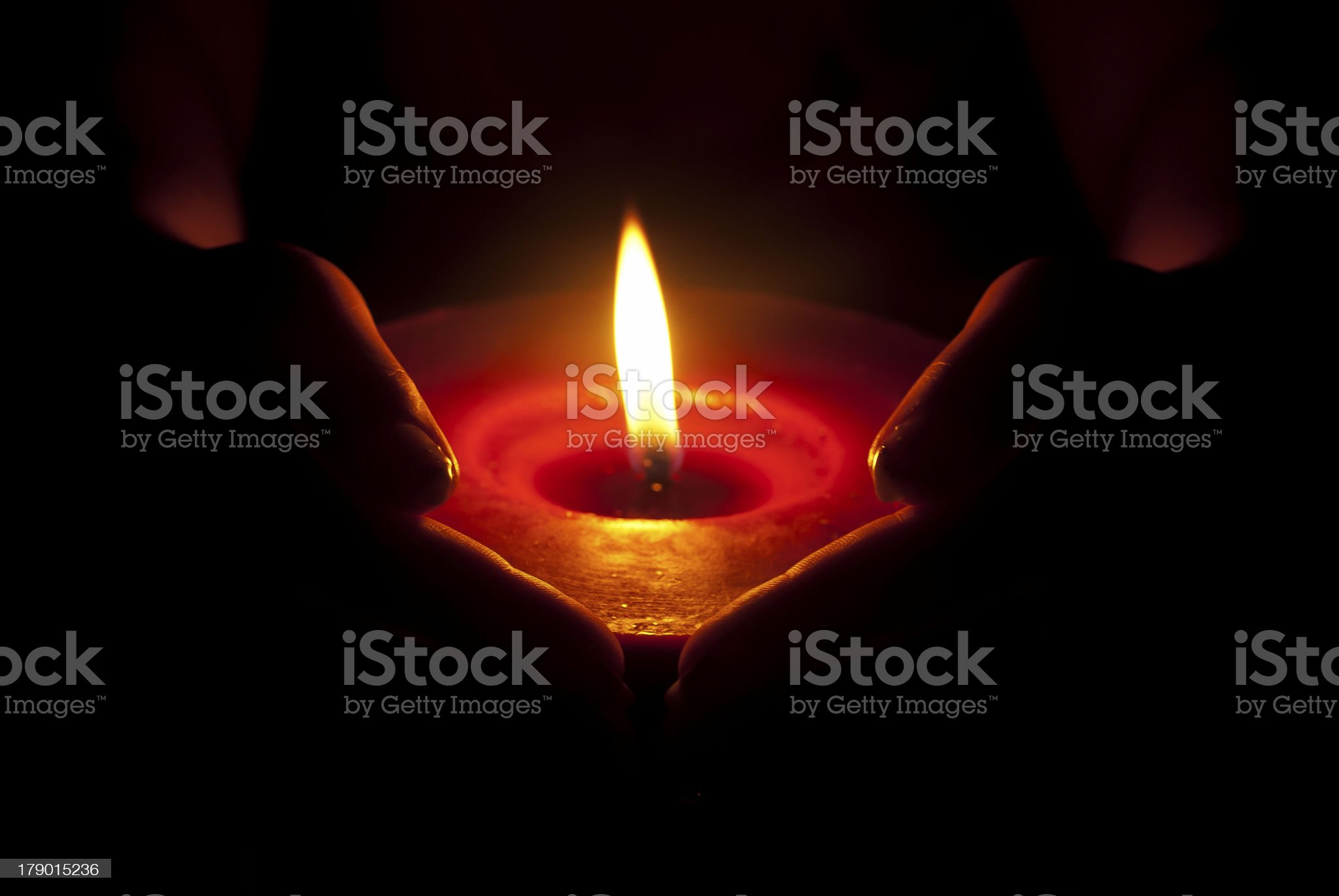 Candle in the hands royalty-free stock photo