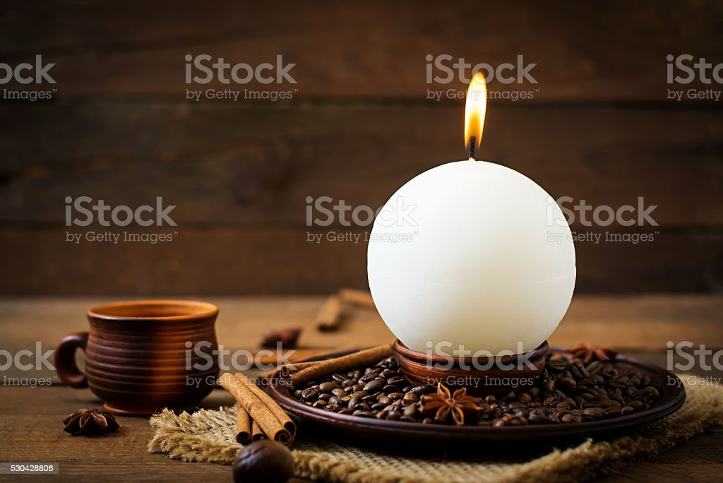 Candle in the shape of balls and coffee stock photo
