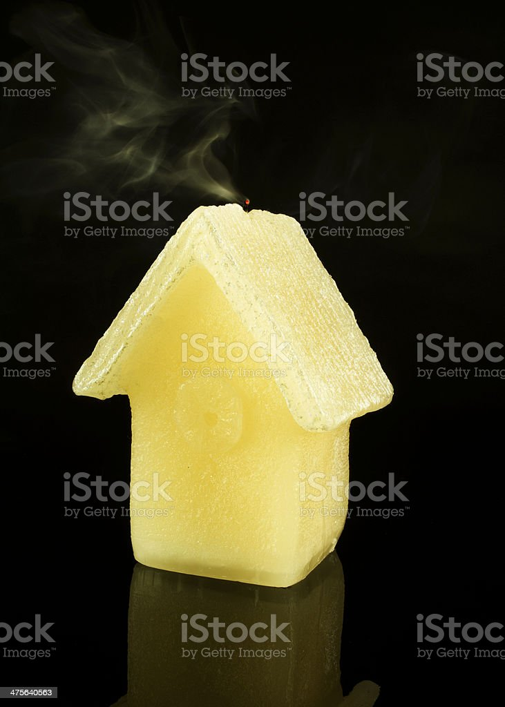 Candle isolated on black with smoke... royalty-free stock photo
