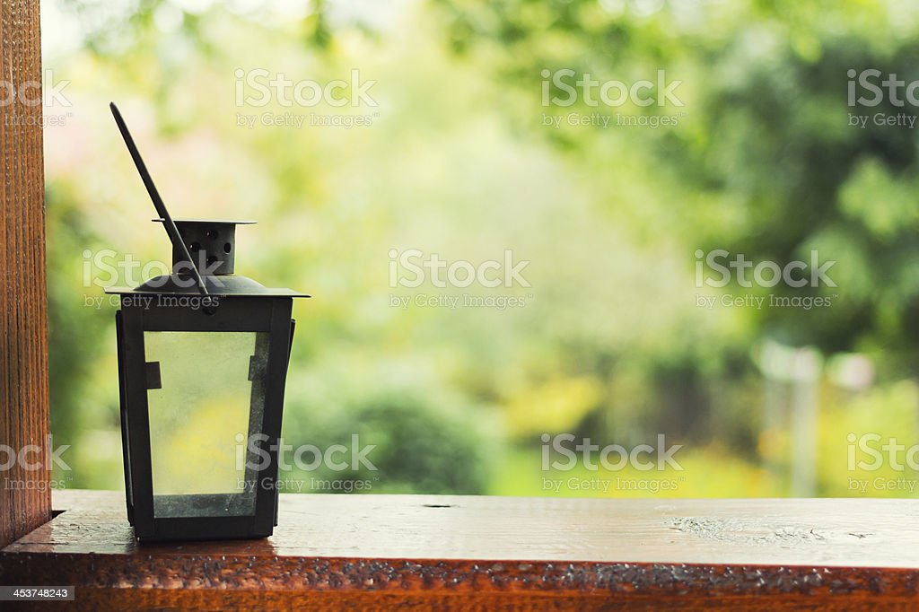 Candle lamp on terrace stock photo