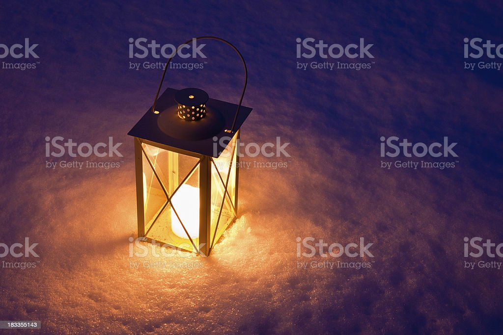 Candle Lantern In Snow at Twilight royalty-free stock photo