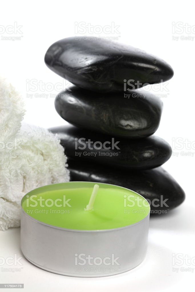 Candle, lava stones and towels royalty-free stock photo