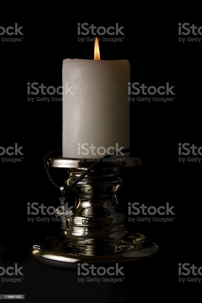 Candle light and cross royalty-free stock photo