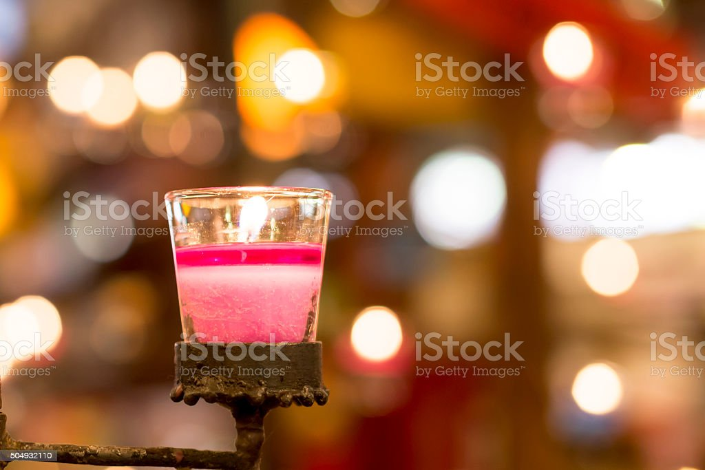 Candle light in cup stock photo