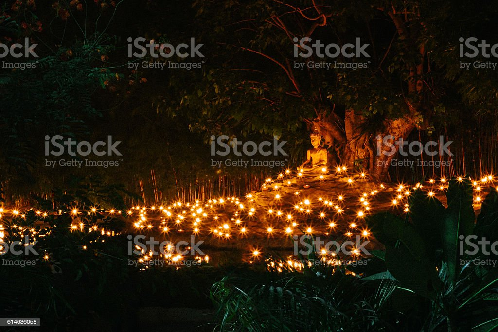 Candle Light with Buddha Statue at Wat Pan Tao Temple stock photo