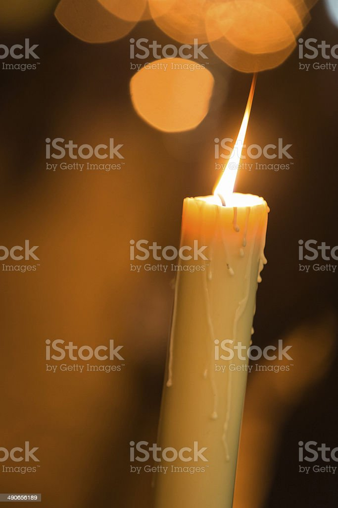 Candle light with light bokeh in the background stock photo
