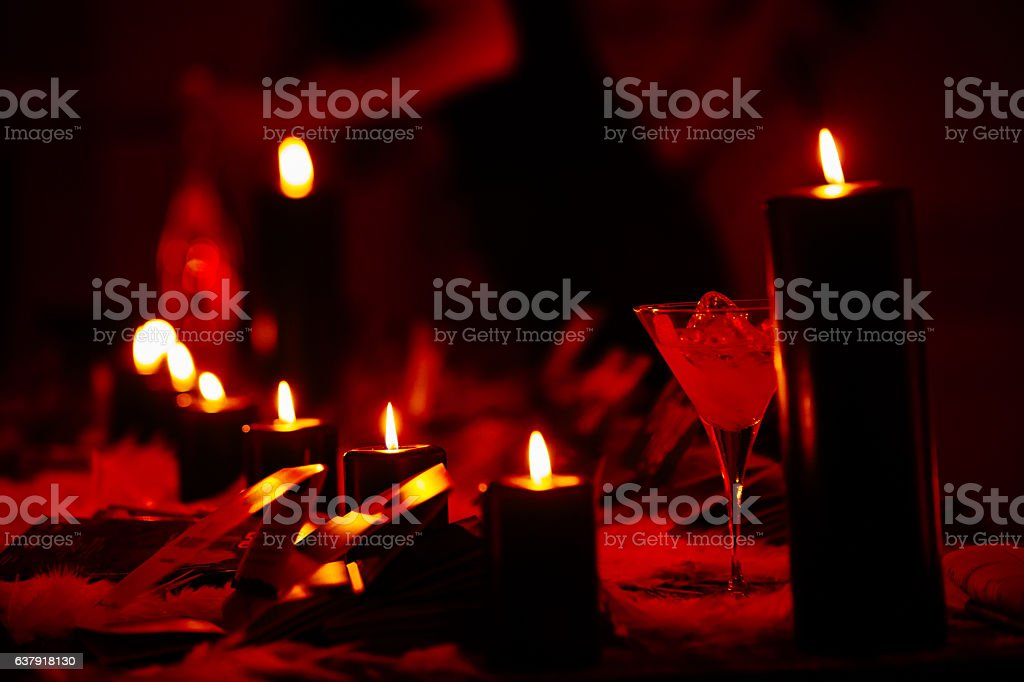 Candle lights and drinks in red light stock photo