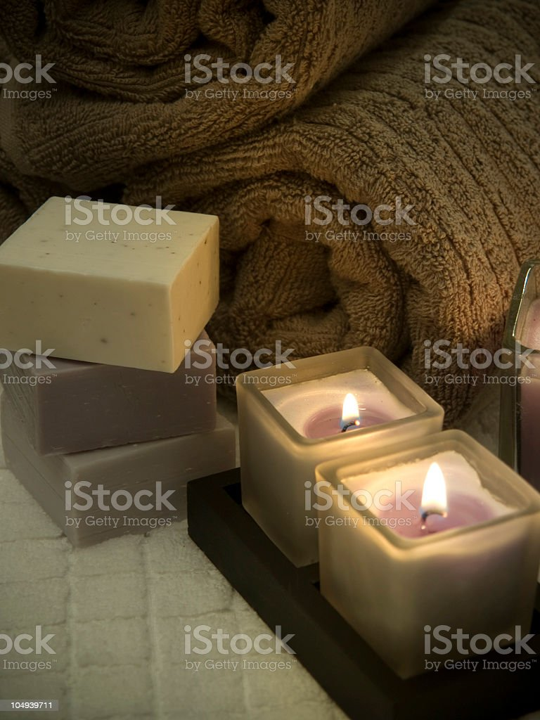 Candle lit bath towels and fancy soaps royalty-free stock photo