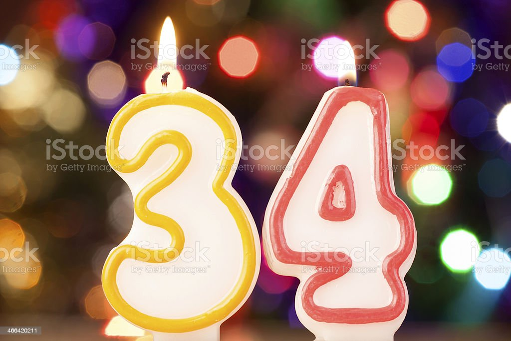 Candle number 34 stock photo