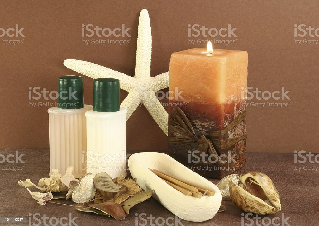 candle, oils and starfish in an aromatherapy setting royalty-free stock photo