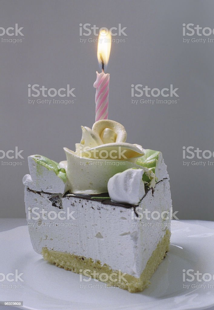 Candle on a cake stock photo
