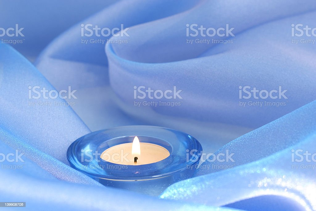 candle on blue royalty-free stock photo